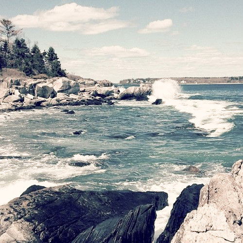 waves crash against a rocky Maine coast